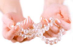 Girl holding beads. Girl with pearl beads in her hands Stock Photos