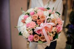 Girl holding a beautiful bouquet of different rosy-colour flowers Royalty Free Stock Photo