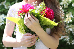 Girl holding a beautiful bouquet of flowers. Girl holding a beautiful bouquet royalty free stock images