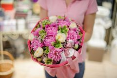 Girl holding a beautiful bouquet of pink peonies and white ranunculuses Royalty Free Stock Images