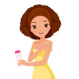 Girl Holding Beauty Packaging And Scrubbing On Skin Royalty Free Stock Photography