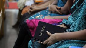 Girl holding Bible stock footage