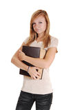 Girl holding big book. Royalty Free Stock Photography