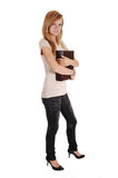 Girl holding big book. Stock Image