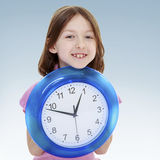 Girl holding a big clock. Stock Photography
