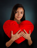 Girl Holding a Big Plush Heart Royalty Free Stock Photos