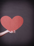 Girl holding big red heart in hands Stock Photo