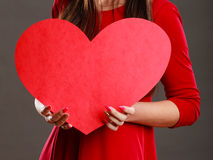 Girl holding big red heart in hands Royalty Free Stock Images