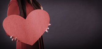 Girl holding big red heart in hands Stock Images