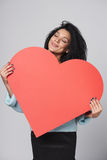 Girl holding big red heart shape Stock Image
