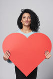 Girl holding big red heart shape Royalty Free Stock Images