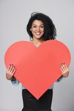 Girl holding big red heart shape Royalty Free Stock Photography