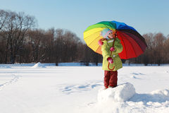 Girl holding big umbrella in winter Royalty Free Stock Photos