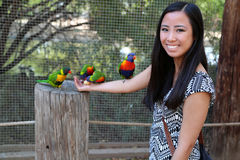 Girl holding birds Royalty Free Stock Images