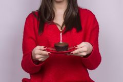 Girl holding birthday candle. Birthday cake girl part body red celebration isolated on white backgorund Stock Photo