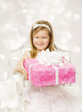 Girl holding birthday present. Happy little child  Stock Images