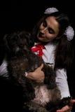 Girl holding black dog Royalty Free Stock Images
