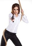 Girl holding a black gun Stock Photography