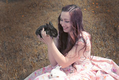Girl holding a black rabbit Royalty Free Stock Photo