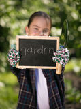 Girl holding blackboard with text Royalty Free Stock Photography
