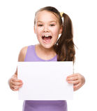 Girl is holding blank banner Stock Images