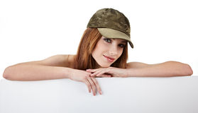 Girl holding a blank billboard. Royalty Free Stock Image