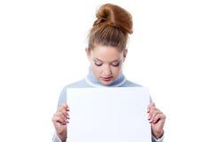 Girl holding blank billboard Stock Image