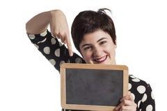 Girl Holding Blank Blackboard on white Royalty Free Stock Photography