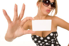Girl holding blank business card Royalty Free Stock Image