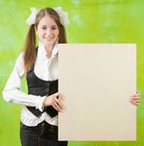 Girl   holding  blank canvas Royalty Free Stock Photos