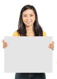 Girl holding blank card Royalty Free Stock Photos