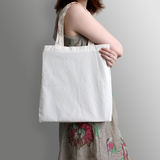 Girl is holding blank cotton eco tote bag, design mockup. Stock Photos