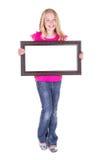 Girl holding blank frame Stock Image