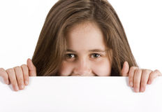 Girl holding blank message board. Smiling girl holding blank a message board royalty free stock image