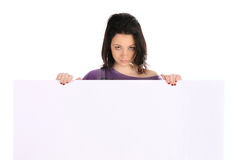 Girl holding a blank over white background Royalty Free Stock Photo