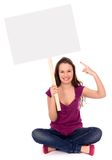 Girl holding blank placard Royalty Free Stock Photos