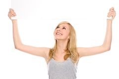Girl holding blank placard above her head Royalty Free Stock Photos
