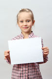 Little girl holding a blank sign Stock Photo