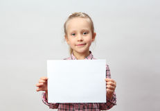 Little girl holding a blank sign Stock Images
