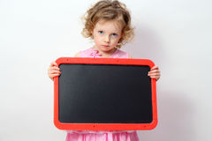 Little girl  holding a blank sign Stock Photography