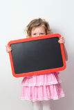 Little girl  holding a blank sign Royalty Free Stock Image