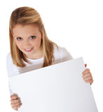 Girl holding blank sign. Attractive young woman holding blank sign. All on white background Stock Photo