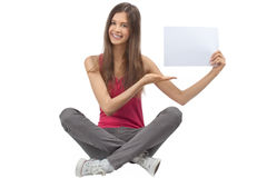 Girl holding a blank signboard Stock Images