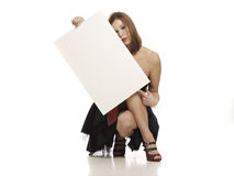 Girl holding blank white  board Royalty Free Stock Images