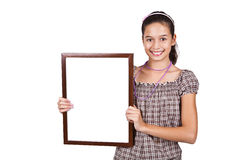 Girl holding a blank white card for text. stock photo