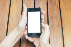 Girl holding blank white smartphone Stock Photos