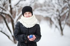 Girl holding blue ball in hands stock photography