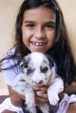 Girl Holding Blue Eyed Puppy