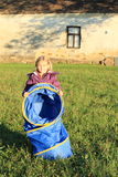 Girl holding blue kids tunnel Stock Photos