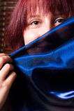 Girl holding blue scarf Royalty Free Stock Photo